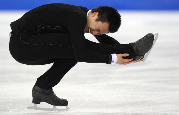 163 260310 19 FK - Японец Такахаси завоевал золото чемпионата мира  по фигурному катанию. Фото