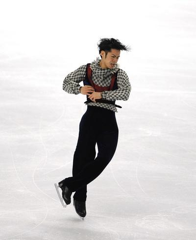 163 260310 3 FK - Японец Такахаси завоевал золото чемпионата мира  по фигурному катанию. Фото