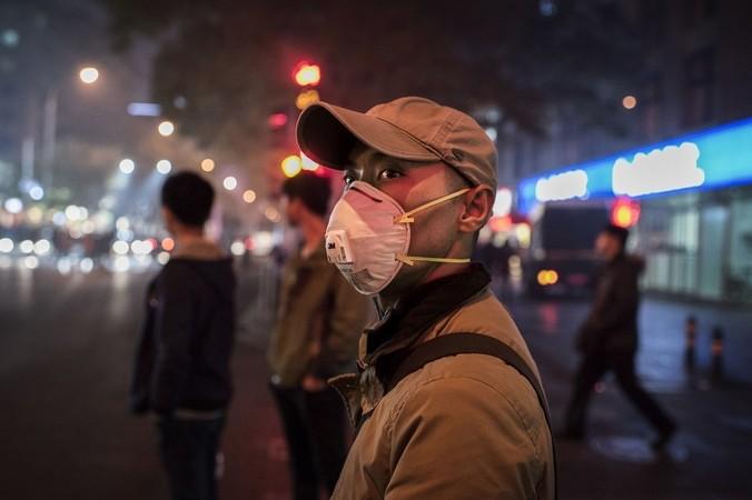 Смог в Пекине. Фото: Kevin Frayer/Getty Images | Epoch Times Россия