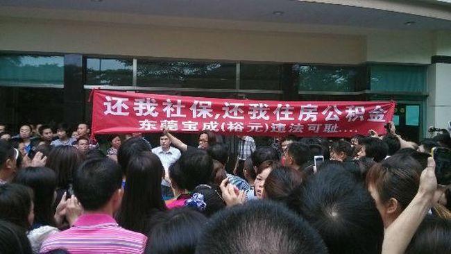 Забастовка рабочих обувной фабрики. Провинция Гуандун. Фото с ntdtv.com | Epoch Times Россия