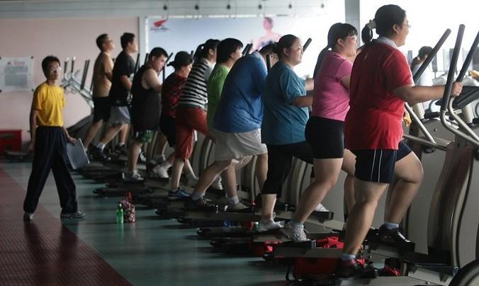 В Китае становится всё больше людей с избыточным весом. Фото: Photo by China Photos/Getty Images | Epoch Times Россия