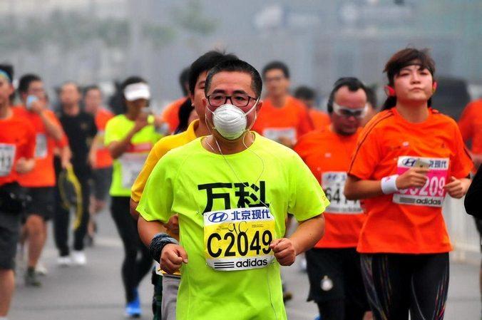 Участники 34-ого Пекинского международного марафона, Китай, 19 октября, 2014 год. Фото:  STR / AFP / Getty Images | Epoch Times Россия