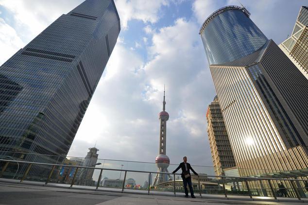 Даже в экономически сильном Шанхае уже 60% кредитных посредников обанкротились. Фото: Peter Parks/AFP/Getty Images   Epoch Times Россия