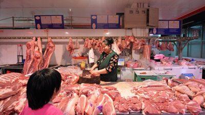 Крестьянка предостерегает: употребление свинины в Китае равняется самоубийству