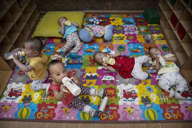 Китайские дети-сироты в детском доме в Пекине 2 апреля 2014 г. Фото: Kevin Frayer/Getty Images | Epoch Times Россия