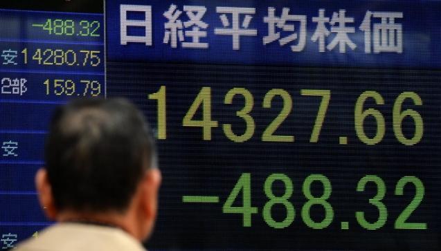 В Китае второе крупное госпредприятие уходит с биржи: в ближайшее время это может стать нормой. Фото: TORU YAMANAKA/AFP/Getty Images | Epoch Times Россия