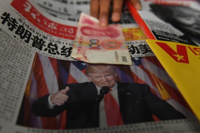 Китайская газета с портретом избранного президента США Дональда Трампа на пресс-стенде в Пекине 10 ноября 2016 года. Фото: Greg Baker/AFP/Getty Images   Epoch Times Россия