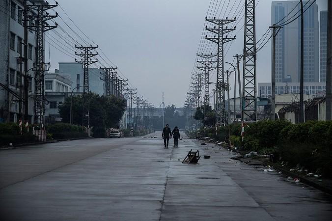 Заброшенная улица в промышленном районе города Хоуцзе, Китай, 27 января 2016 года. Фото: Lam Yik Fei/Getty Images   Epoch Times Россия