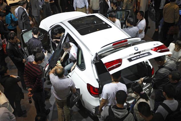 BMW X5 на автосалоне Auto China в Пекине в мае 2014 года. Фото: STR/AFP/Getty Images   Epoch Times Россия