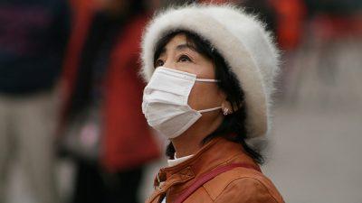 Красное предупреждение в Пекине не решает проблему загрязнённого воздуха в стране