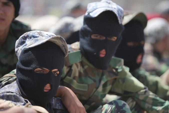 Шиитские добровольцы вступили в иракскую армию для борьбы против боевиков исламского государства ИГИЛ 9 июля 2014 года в Багдаде. Фото: AHMAD AL-RUBAYE/AFP/Getty Images | Epoch Times Россия