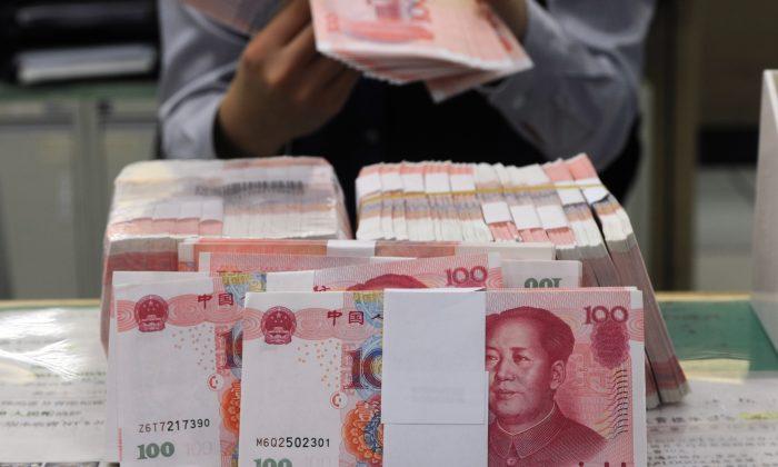 На протяжении десятилетий законы Китая о подоходном налоге усугубляли разрыв в уровне благосостояния в Китае, дискриминируя группы с низким доходом (Sam Yeh / AFP / Getty Images)   Epoch Times Россия