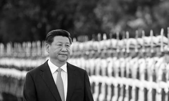 Лидер компартии Китая Си Цзиньпин присутствует на церемонии встречи лидеров Малайзии у Большого зала народных собраний в Пекине, Китай, 4 сентября 2014 года. Си усилил свой контроль над Политической и правовой комиссией с прямым управлением, сообщают государственные СМИ 23 октября 2014 г. (Lintao Zhang / Getty Images) | Epoch Times Россия