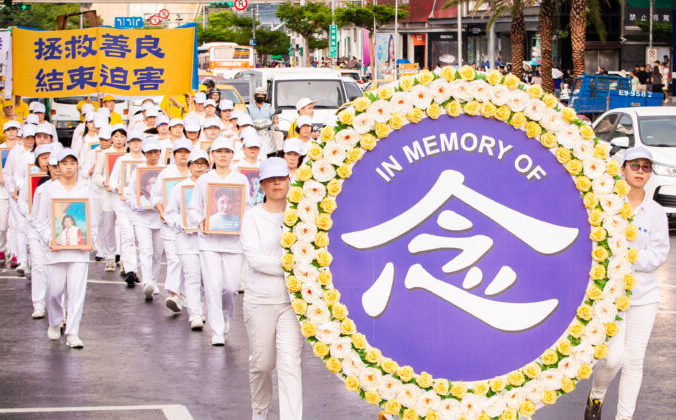 Практикующие Фалуньгун на марше в ознаменование 20-й годовщины преследования в Китае. Тайбэй, Тайвань, 20 июля 2019 года. Фото: Chen Po-chou/The Epoch Times | Epoch Times Россия