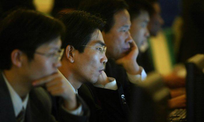 Коммунистическая партия Китая жестко контролирует Интернет в Китае, используя пять основных подходов. (Фредерик Дж. Браун / AFP / Getty Images)   Epoch Times Россия