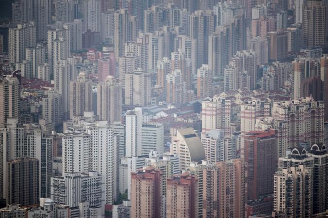 Вид на Шанхай, 8 мая 2015 г. Фото: JOHANNES EISELE/AFP/Getty Images | Epoch Times Россия