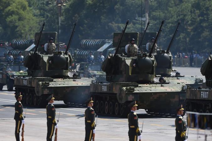 Военный парад на площади Тяньаньмэнь в Пекине, 3 сентября 2015 г. Фото: Greg Baker/AFP/Getty Images | Epoch Times Россия