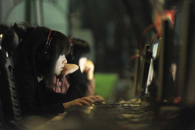 Интернет-кафе в Пекине. Киберпреступники в Китае активизируются в Даркнете. Фото: Gou Yige/AFP/Getty Images | Epoch Times Россия