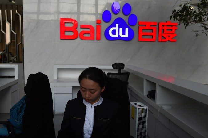 Регистратор в Baidu, Пекин, 17 декабря 2014 г. Фото: Greg Baker/AFP/Getty Images | Epoch Times Россия