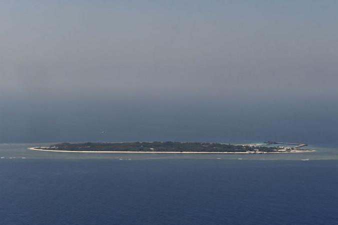Один из спорных островов в Южно-Китайском море. Фото: SAM YEH/AFP/Getty Images   Epoch Times Россия