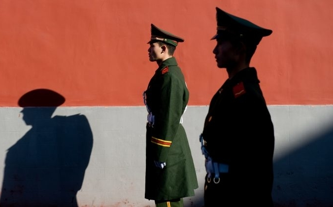 Полицейские стоят на страже в Пекине, Китай. Saul Loeb / AFP / Getty Images   Epoch Times Россия