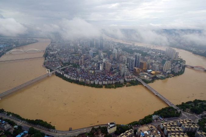 Наводнения в южном Китае. Район Гуанси. Июль 2016 года. Фото: STR/AFP/Getty Images   Epoch Times Россия