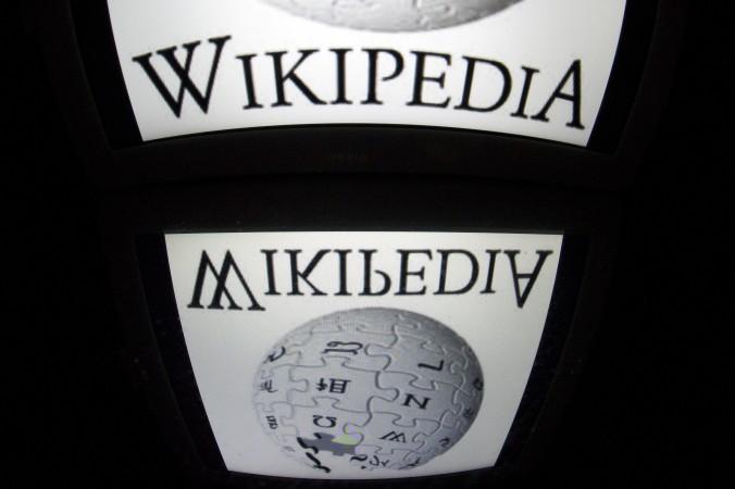 Логотип Wikipedia отображается на экране планшета . Фото: Lionel Bonaventure/AFP/Getty Images   Epoch Times Россия