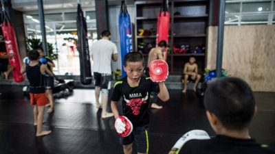 В результате пожара в китайском центре боевых искусств погибли 18 человек, в основном дети