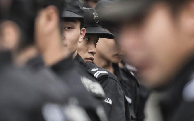 Стенд китайской службы безопасности на площади Тяньаньмэнь в Пекине 30 августа 2015 г. (Fred Dufour / AFP / Getty Images) | Epoch Times Россия