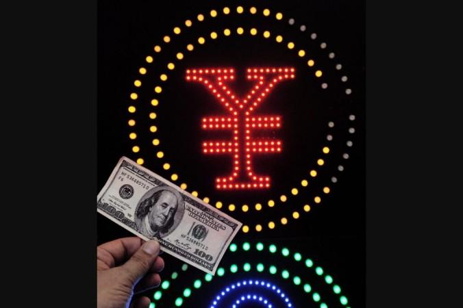 Анализ: банки Китая ломятся от долларов, и это тревожит