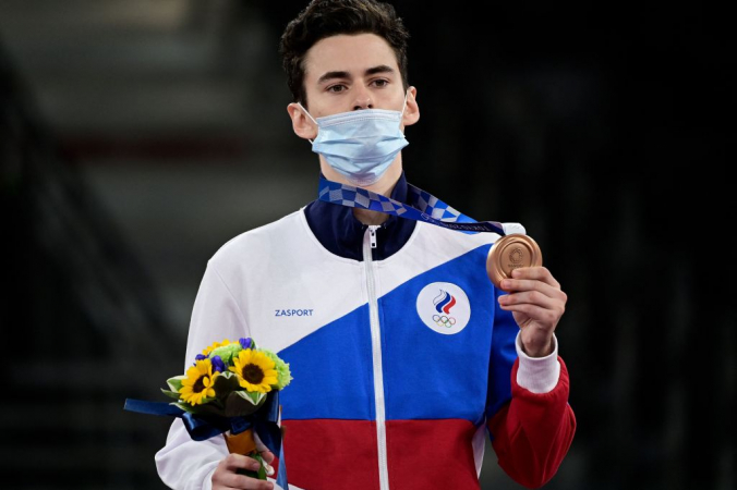 Россиянин Михаил Артамонов завоевал бронзовую медаль среди мужчин по тхэквондо в весовой категории до 58 кг на Олимпиаде-2020 в Токио, 24 иля 2021 год. Фото: by JAVIER SORIANO/AFP via Getty Images | Epoch Times Россия