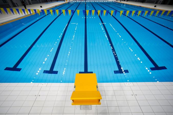 Центр водных видов спорта Токио, вкотором будут проводиться соревнования поплаванию, дайвингу иплаванию наОлимпийских иПаралимпийских играх вТокио. 24февраля 2020г. (REUTERS / Issei Kato)   Epoch Times Россия