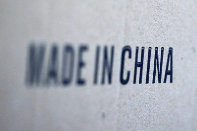 Надпись «Сделано в Китае» на коробке с товарами, импортированными из Китая. (Regis Duvignau / Reuters)   Epoch Times Россия