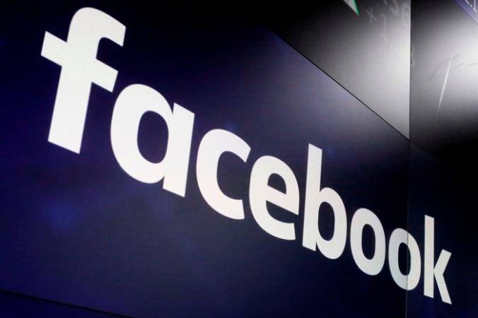 Логотип Facebook появится на экранах Nasdaq MarketSite на Таймс-сквер в Нью-Йорке 29 марта 2018 г. (Richard Drew/AP Photo)   Epoch Times Россия