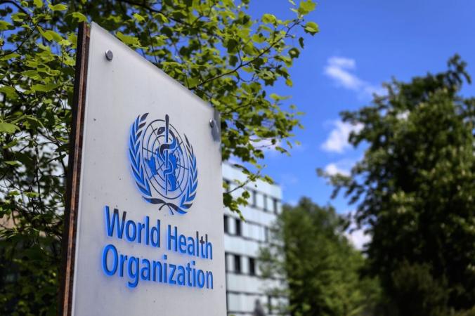 Вывеска Всемирной организации здравоохранения в Женеве, Швейцария, 24 апреля 2020 г. (Fabrice Coffrini / AFP via Getty Images) | Epoch Times Россия
