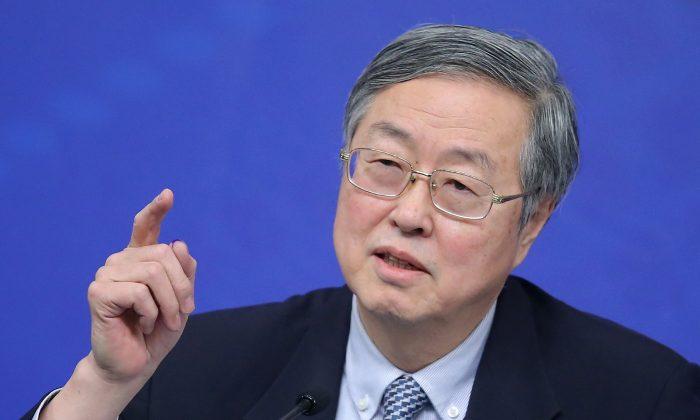 Чжоу Сяочуань, управляющий Народного банка Китая, в Пекине, 12 марта 2015 г. Feng Li / Getty Images | Epoch Times Россия