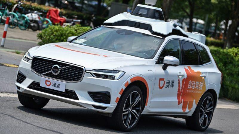Такси Didi проводит тест-драйв наулицах Шанхая 22июля 2020г. (Hector Retamal / AFP via Getty Images) | Epoch Times Россия