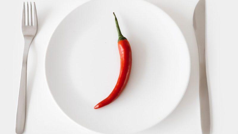 chili pepper on a plate 1200x823 1 800x450 - Польза чили для здоровья