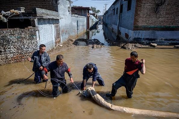 Применение насосов при наводнениях. | Epoch Times Россия