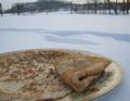 На Масленицу в Вологде устроили бега и съели трёхметровый блин