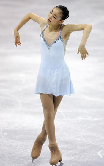 «Полет жаворонка»: произвольная программа на этапе Гран-При-2006 Skate Canada в Виктории. Фото: ROBYN BECK/AFP/Getty Images