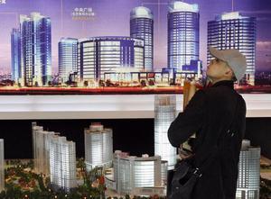 Из 10 самых крупных земельных компаний Шанхая 9 принадлежат родственникам местных чиновников. Фото: MARK RALSTON/AFP/Getty Images
