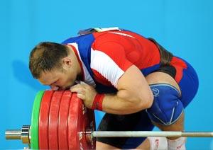 В тяжелой весовой категории свыше 105 килограммов второй результат показал Евгений Чигишев.   Фото: JUNG YEON-JE/AFP/Getty Images