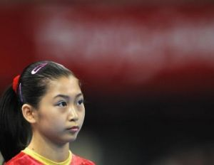Юйюань Цзин на Олимпийских играх в Пекине во время индивидуальных соревнований по спортивной гимнастике среди женщин 15 августа  2008 г. Фото:  Franck Fife/AFP/Getty Images
