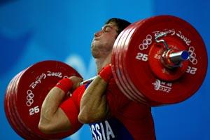Штангист Дмитрий Клоков в финале весовой категории 105 килограммов занял второе место. Фото: Ezra Shaw/Getty Images
