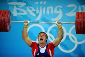 Штангист Дмитрий Лапиков показал третий результат. Фото: JUNG YEON-JE/AFP/Getty Images