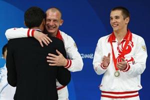 Российские прыгуны в воду Дмитрий Саутин и Юрий Кунаков завоевали серебряные награды в синхронных прыжках с 3-метрового трамплина на Олимпиаде. Фото: Nick Laham/Getty Images
