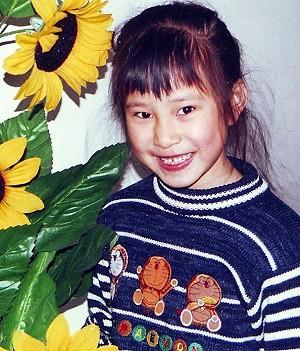 Лу Минхуэй, чей отец Лу Мэнсинь замучен до смерти, и чья мать по-прежнему в тюрьме. Фото: Minghui.net