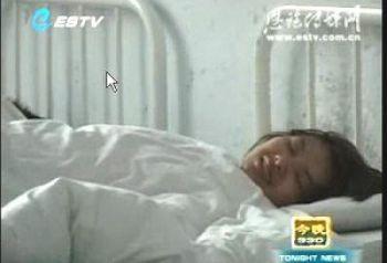 Ден Юйцзяо, запертая в психиатрической лечебнице. Снимок с экрана ТВ г.Эньши. Фото: Векликая Эпоха