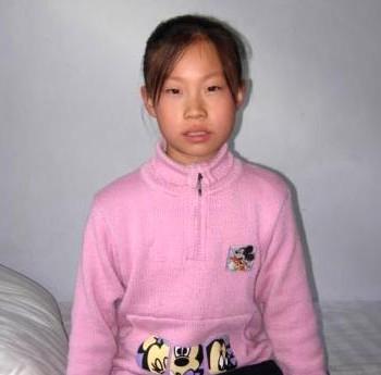 Чжан Синьтун, отца которой убили в тюрьме. Фото: minghui.ca